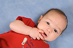 3 month old baby boy portrait closeup sucking finger  horizontal on back Hispanic Puerto Rican