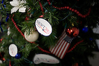 A Christmas tree is decorated with Newt2012 stickers and American flags at the Newt Gingrich New Hampshire campaign headquarters in Manchester, New Hampshire, on Jan. 7, 2012. Gingrich is seeking the 2012 Republican presidential nomination.
