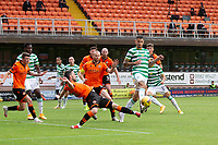 22nd August 2020; Tannadice Park, Dundee, Scotland; Scottish Premiership Football, Dundee United versus Celtic; Mohamed Elyounoussi of Celtic challenges for the ball with Nicky Clark of Dundee United in the Dundee box