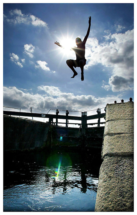 George McCabe, from Crumlin, pictured here making the most of the summer sun as he leaps into cool waters at the royal Canal, Dublin. Pic. Robbie Reynolds.