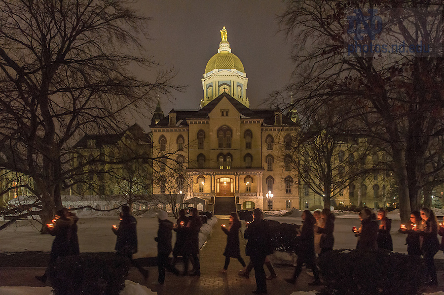 Mar. 4, 2015; Residents of Lewis Hall carry candles as they walk to the Basilica of the Sacred Heart in the overnight hours to pay respects at the visitation of President Emeritus Rev. Theodore M. Hesburgh, C.S.C. (Photo by Matt Cashore/University of Notre Dame)