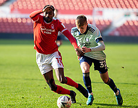 9th January 2021; City Ground, Nottinghamshire, Midlands, England; English FA Cup Football, Nottingham Forest versus Cardiff City; Sammy Ameobi of Nottingham Forest  and Joel Bagan of Cardiff City tussle for the ball at their feet
