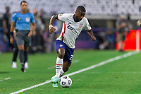 DALLAS, TX - JULY 25: Shaq Moore #20 of the United States moves with the ball during a game between Jamaica and USMNT at AT&T Stadium on July 25, 2021 in Dallas, Texas.