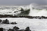 Waves crashing into Bean Hollow State Beach churn up a blanket of white seafoam.