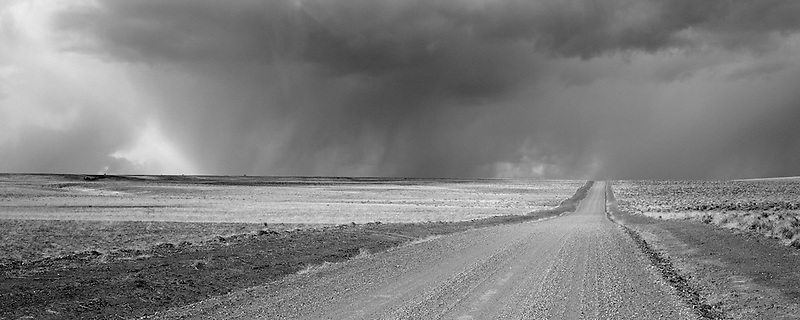 M00247M.tiff  Lone road with thunderstorm. Near Hart Mountain, Oregon