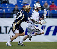 Collin Finnerty (20) of Loyola works his way around David Earl (33) of Notre Dame during the Face-Off Classic in at M&T Stadium in Baltimore, MD