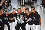 """Fashion designer Nick Graham poses with Icon Dance Complex group at the close of his Nick Graham Spring Summer 2019 """"1969"""" collection in at Cadillac House in New York City on July 10, 2018; during New York Fashion Week: Men's Spring Summer 2019."""