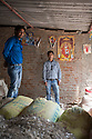 India - Jharkhand - Domchanch. - Sudesh Modi (right), 29, and Vivek Modi, 30 are two mica dealers living and working in the city of Domchanch. After buying mica from several collecting agents in the area, the two brothers clean it and sell it to the exporters in Kolkata.