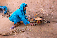 Ksar Elkhorbat, Morocco.  Amazigh Berber Woman Baking Bread.