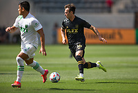 LOS ANGELES, CA - APRIL 17: Danny Musovski #16 of LAFC moves with the ball during a game between Austin FC and Los Angeles FC at Banc of California Stadium on April 17, 2021 in Los Angeles, California.