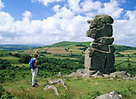 Great Britain, England, Devon, Dartmoor National Park, Walker at Rock formation known as Bowerman's Nose near village of Widecombe in the Moor | Grossbritannien, England, Devon, Dartmoor National Park, Wanderer bei Bowerman's Nose, Felsformation beim Dorf Widecombe in the Moor