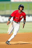 Tim Anderson (2) of the Kannapolis Intimidators hustles towards third base against the Greensboro Grasshoppers at CMC-Northeast Stadium on July 13, 2013 in Kannapolis, North Carolina.  The Intimidators defeated the Grasshoppers 7-5.   (Brian Westerholt/Four Seam Images)