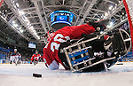 Sochi, RUSSIA - Mar 13 2014 - A shot gets past Corbin Watson as Canada takes on USA in Sledge Hockey Semi-Final at the 2014 Paralympic Winter Games in Sochi, Russia.  (Photo: Matthew Murnaghan/Canadian Paralympic Committee)
