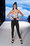 Model walks runway in an outfit from the Camellia Couture Spring Summer 2020 runway show by Debbie Holden, for The Society Fashion Week Spring Summer 2020 during New York Fashion Week, on September 7, 2019.