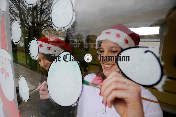Laura King and Laura Daly painting the windows of St Josephs Hospital.Pic Arthur Ellis.