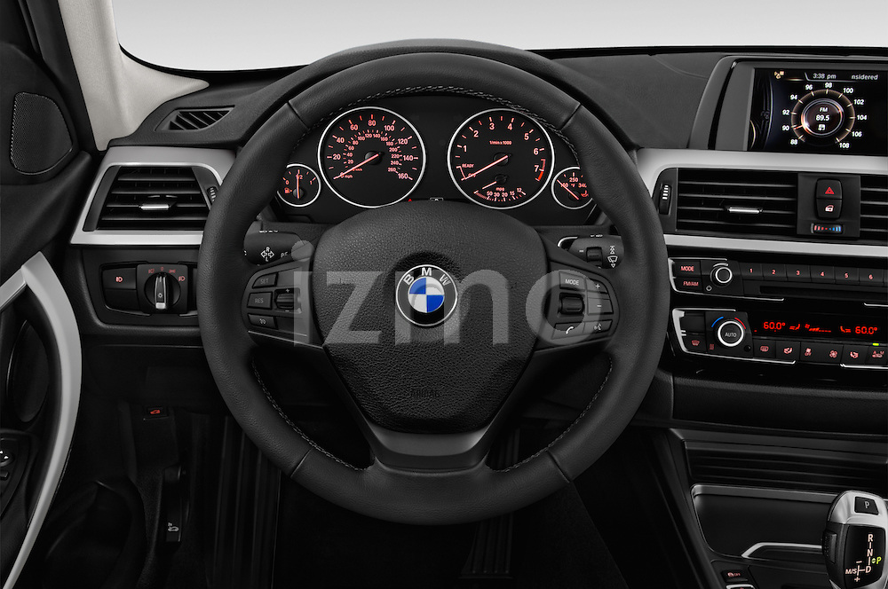 Car pictures of steering wheel view of a 2018 BMW 3-Series 320i 4 Door Sedan Steering Wheel