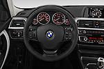 Car pictures of steering wheel view of a 2018 BMW 3-Series 320i 4 Door Sedan Steering Wheel