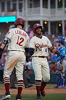 Frisco RoughRiders Andretty Cordeo (4) high fives Charles Leblanc (12) during a Texas League game against the Amarillo Sod Poodles on May 17, 2019 at Dr Pepper Ballpark in Frisco, Texas.  (Mike Augustin/Four Seam Images)