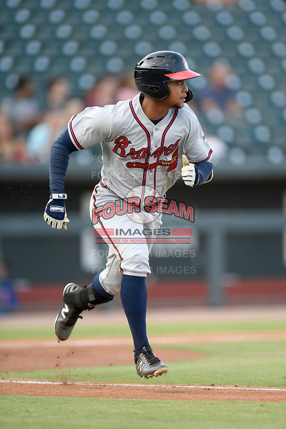 Third baseman Derian Cruz (66) of the Rome Braves runs out a batted ball in a game against the Columbia Fireflies on Tuesday, June 4, 2019, at Segra Park in Columbia, South Carolina. Columbia won, 3-2. (Tom Priddy/Four Seam Images)