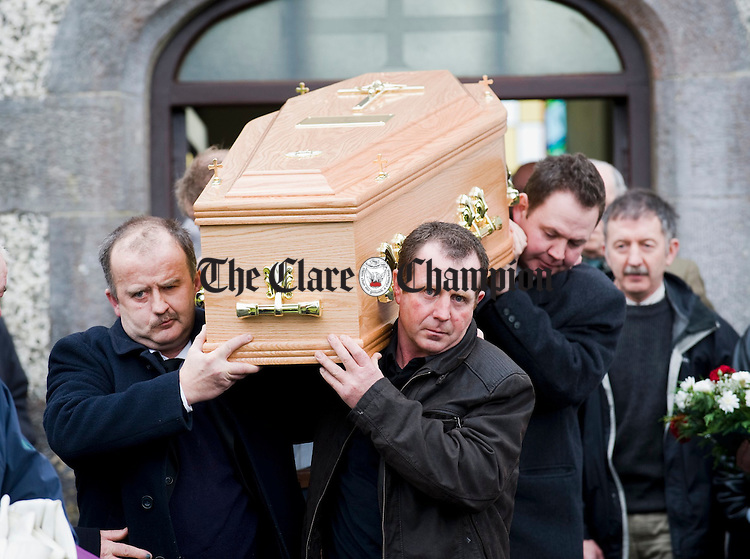 The coffin of Joe Ryan is carried out of Inagh church following his funeral mass for burial in the local graveyard. Photograph by John Kelly.
