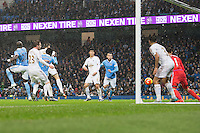 Wilfried Bony scores his sides first goal during the Barclays Premier League Match between Manchester City and Swansea City played at the Etihad Stadium, Manchester on 12th December 2015