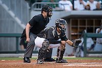 Charlotte Knights catcher Omar Narvaez (14) sets a target as home plate umpire John Bacon looks on during the game against the Columbus Clippers at BB&T BallPark on May 3, 2016 in Charlotte, North Carolina.  The Clippers defeated the Knights 8-3.  (Brian Westerholt/Four Seam Images)
