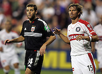 9 April 2005.  Ben Olsen (14) of DC United and Jesse Marsch (15)  of the Chicago Fire wait for the corner kick to come into the box  at RFK Stadium in Washington, DC.