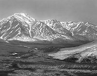 """""""Alaska Pipeline in the Brooks Range""""<br /> Alaska <br /> <br /> The Alaska Pipeline was constructed during the 1970's to carry crude oil from Alaska's northern coast at Prudhoe Bay of the Arctic Ocean to Alaska's southern coast at Valdez. Much of the pipeline's 800 mile length is located above the Arctic Circle and traverses the Brooks Mountain Range. The 414 mile Dalton Highway was constructed to provide access to the pipeline and runs alongside much of it. This black and white photograph shows the Alaska Pipeline near the images's center and the Dalton Highway entering from the lower right image corner as they travel through the Brooks Range."""