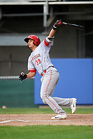 Greeneville Reds third baseman Raul Juarez (39) follows through on a swing during the second game of a doubleheader against the Princeton Rays on July 25, 2018 at Hunnicutt Field in Princeton, West Virginia.  Greeneville defeated Princeton 8-7.  (Mike Janes/Four Seam Images)