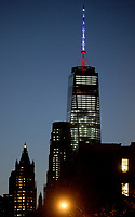 NEW YORK, NY - NOVEMBER 14: Empire State Building dark, World Trade Center lit in French flag colors. The 408-foot spire atop One World Trade Center was lit again Saturday night in the colors of the French flag. New York Gov. Andrew Cuomo says the spire will remain lit blue, white and red on Sunday<br /> <br /> People:  World Trade Center