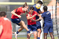 BRADENTON, FL - JANUARY 23: Walker Zimmerman, Aaron Long, Mauricio Pineda battle for a ball during a training session at IMG Academy on January 23, 2021 in Bradenton, Florida.