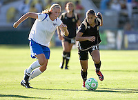 Stacy Bishop (left) and Adriane (21) chase down the ball. Boston Breakers defeated FC Gold Pride 1-0 at Buck Shaw Stadium in Santa Clara, California on July 19, 2009.