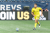 FOXBOROUGH, MA - OCTOBER 3: Dave Romney #4 of Nashville SC brings the ball forward during a game between Nashville SC and New England Revolution at Gillette Stadium on October 3, 2020 in Foxborough, Massachusetts.