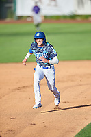 Sam McWilliams (5) of the Ogden Raptors hustles towards third base against the Grand Junction Rockies at Lindquist Field on June 14, 2019 in Ogden, Utah. The Raptors defeated the Rockies 12-0. (Stephen Smith/Four Seam Images)