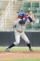 Raimel Tapia (15) of the Asheville Tourists at bat against the Kannapolis Intimidators at CMC-NorthEast Stadium on July 13, 2014 in Kannapolis, North Carolina.  The Tourists defeated the Intimidators 8-2.  (Brian Westerholt/Four Seam Images)