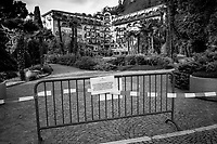 "Switzerland. Canton Ticino. Lugano. A police line and a metal barrier forbid the access to the garden of Grand Hotel Villa Castagnola because of coronavirus (also called Covid-19). Due to the spread of the coronavirus , the Federal Council has categorised the situation in the country as ""extraordinary"". It has issued a recommendation to all citizens to stay at home, especially the sick and the elderly. From March 16 the government ramped up its response to the widening pandemic, ordering the closure of bars, restaurants, sports facilities and cultural spaces. Only businesses providing essential goods to the population – such as grocery stores, bakeries and pharmacies – are to remain open. 13.04.2020 © 2020 Didier Ruef"
