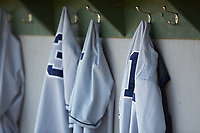 Xavier Musketeers jerseys hang up in the dugout prior to the game against the Penn State Nittany Lions at Coleman Field at the USA Baseball National Training Center on February 25, 2017 in Cary, North Carolina. The Musketeers defeated the Nittany Lions 10-4 in game one of a double header. (Brian Westerholt/Four Seam Images)
