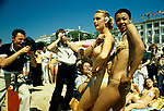Topless girls photographed on the beach at the Cannes Film festival 1980 by local and international paparazzi