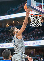 WASHINGTON, DC - DECEMBER 28: Jagan Mosely #4 of Georgetown goes up for a basket. during a game between American University and Georgetown University at Capital One Arena on December 28, 2019 in Washington, DC.
