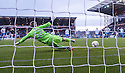 Falkirk's Rory Loy scores from the spot.