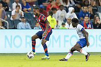 KANSAS CITY, KS - JULY 11: Kellyn Acosta #23 of the United States passes the ball during a game between Haiti and USMNT at Children's Mercy Park on July 11, 2021 in Kansas City, Kansas.