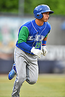 Lexington Legends shortstop Cristian Perez (15) runs to first base during a game against the Asheville Tourists at McCormick Field on May 25, 2018 in Asheville, North Carolina. The Tourists defeated the Legends 6-4. (Tony Farlow/Four Seam Images)