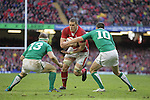 Brian O'Driscoll and Jonny Sexton close the gap on Wales lock Ian Evans..RBS 6 Nations.Wales v Ireland.Millennium Stadium.02.02.13.©Steve Pope-SPORTINGWALES
