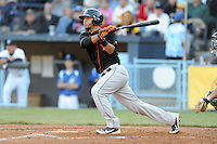 Delmarva Shorebirds catcher Gabriel Lino #10 swings at a pitch during a game between the Delmarva Shorebirds and the Asheville Tourists at McCormick Field, Asheville, North Carolina April 6, 2012. The Shorebirds won the game 7-2  (Tony Farlow/Four Seam Images)..
