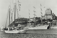 1984 FILE PHOTO - ARCHIVES -<br /> <br /> Heading our way: The 130-foot American schooner Western Union (left) is seen at Quebec city before heading upriver to Toronto. Another of the tall ships sits at anchor below the Chateau Frontenac hotel. The Western Union entered Lake Ontario at 2 a.m. today and anchored off Kingston. She will take part in Saturday's sailpast in Toronto harbor<br /> <br /> 1984<br /> <br /> PHOTO :  Dick Loeb - Toronto Star Archives - AQP