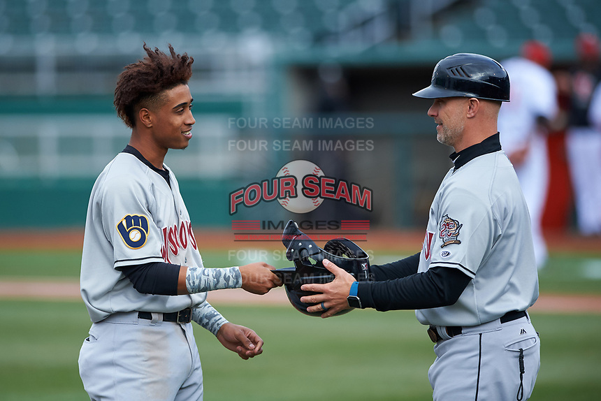 Wisconsin Timber Rattlers Yeison Coca (1) and manager Matt Erickson (8) during a Midwest League game against the Lansing Lugnuts at Cooley Law School Stadium on May 1, 2019 in Lansing, Michigan. Wisconsin defeated Lansing 8-3 after the game was suspended from the previous night. (Zachary Lucy/Four Seam Images)