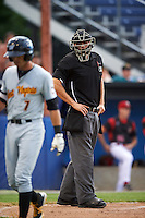 Umpire Dane Ponczak watches Erik Forgione (7) walk back to the dugout after some words during a game between the West Virginia Black Bears and Batavia Muckdogs on June 28, 2016 at Dwyer Stadium in Batavia, New York.  Batavia defeated West Virginia 3-1.  (Mike Janes/Four Seam Images)