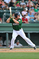 First baseman J.T. Watkins (10) of the Greenville Drive bats in a game against the Charleston RiverDogs on Sunday, August 16, 2015, at Fluor Field at the West End in Greenville, South Carolina. Charleston won, 6-2. (Tom Priddy/Four Seam Images)