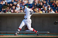 Harvin Mendoza (38) of the Kannapolis Cannon Ballers follows through on his swing against the Charleston RiverDogs at Atrium Health Ballpark on July 4, 2021 in Kannapolis, North Carolina. (Brian Westerholt/Four Seam Images)
