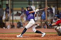 Jodany L Ofarril Ortiz (11) bats during the Perfect Game National Underclass East Showcase on January 23, 2021 at Baseball City in St. Petersburg, Florida.  (Mike Janes/Four Seam Images)